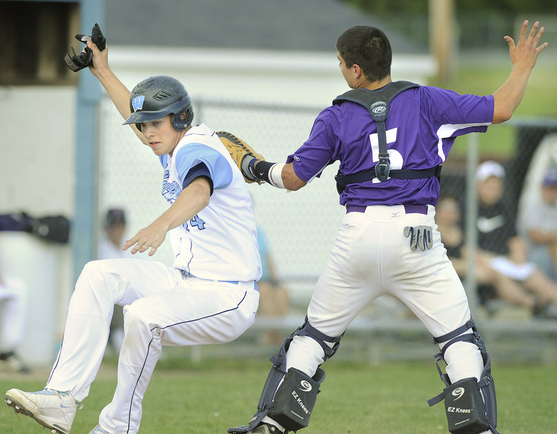 Deering catcher John Miranda tags out Westbrook's Sean Murphy in the second inning of the Blue Blazes' 9-6 win Thursday. Murphy was trying to score from second base on a single by Zach Gardiner.
