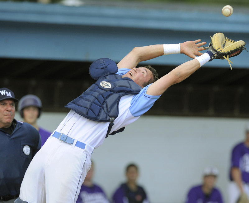 Westbrook catcher Tom Lemay leans back to catch a foul ball hit by Deering's Nick Colucci in the fourth inning of Thursday's game at Olmsted Field. The Blue Blazes won, 9-6.