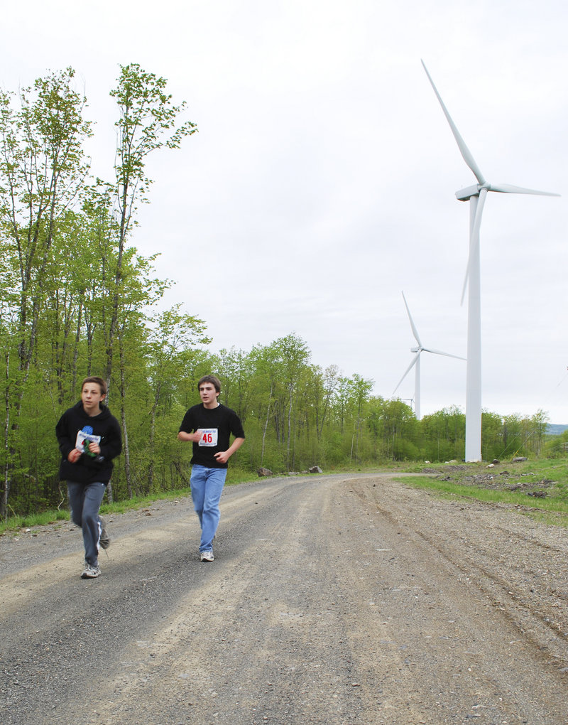 Ethan Vienneau of Milford and Yuval Boss of Orono race to the end of the bushwhacking stage of the fifth annual multi-sport competition. The race across Stetson Mountain also involved a mountain bike segment that was followed by a canoe leg and a climbing wall race.