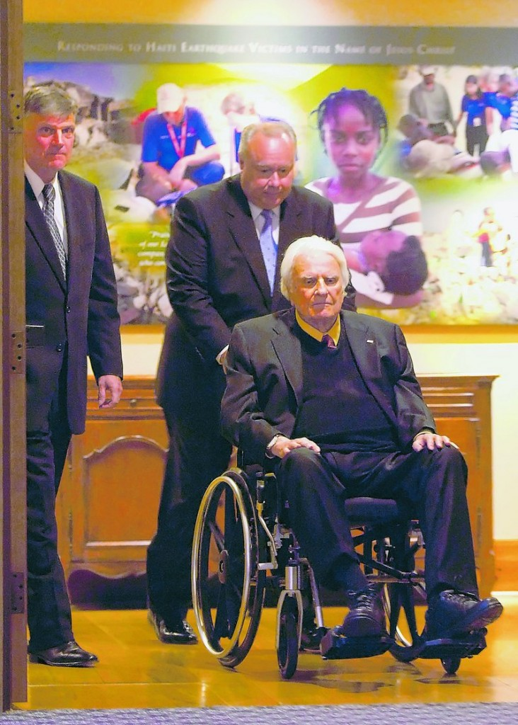 The Rev. Billy Graham, now age 91, is assisted into a dinner last month at the Billy Graham Evangelistic Association's headquarters in Charlotte, N.C.