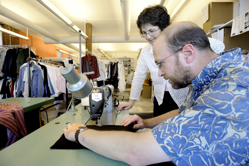 Seamstress Bosiljkac Injac oversees reporter Ray Routhier while he works at the Jill McGowan clothing shop in Portland. Routhier found he could trace and cut the patterns with some competence, but was unnerved by the speed of the sewing machine.