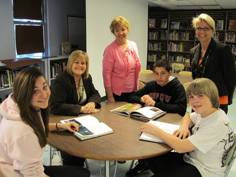 "Students at South Portland's Memorial Middle School are learning the ""power of poetry."" Ready for the program are, from left, Antonia Frisco, student; Melanie Lee, manager Saco & Biddeford Savings, South Portland Branch; Nancy Hutto, intervention strategist at the school; Sam Cross, student; Zared Wilvurn, student; and Sherry Dolloff, school librarian."