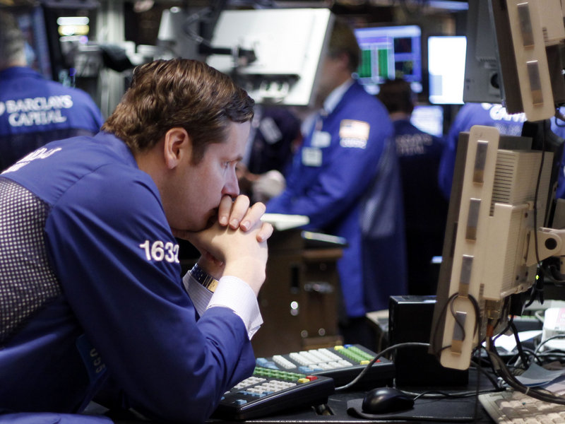 Traders working on the floor at the New York Stock Exchange Thursday had a rare good day, as the market reversed a slide that had seen losses in eight of 10 days.