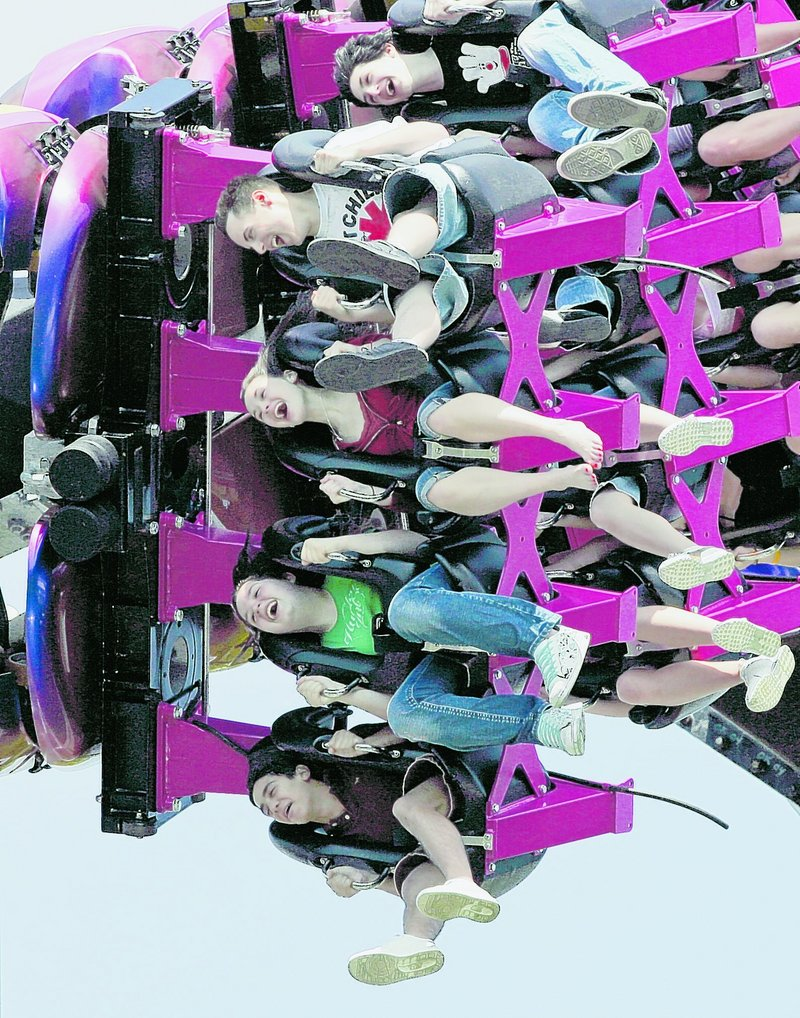 Park patrons scream while riding the Great Bear, an inverted roller coaster at Hersheypark in Hershey, Pa. As an enticement this year, the park is offering guests who stay three nights or more a special $89.95 pass good for unlimited trips to the theme park, zoo, botanical garden and museum. A standard one-day pass is $52.95.