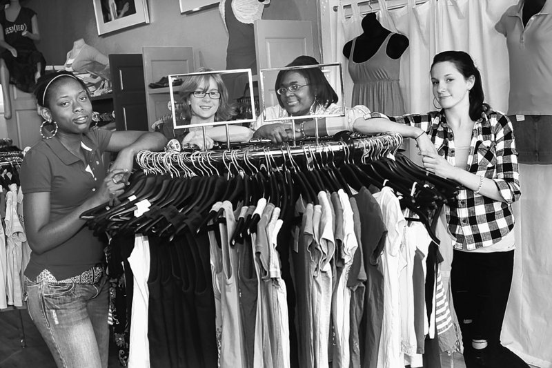 Perquila Rogers, from left, Kelsey Heider, Janyesha Jackson and Stella Richardson, students at Central High School in St. Paul, Minn., are co-founders of Express Yourself Clothing, a resale clothing store just two blocks from the school.