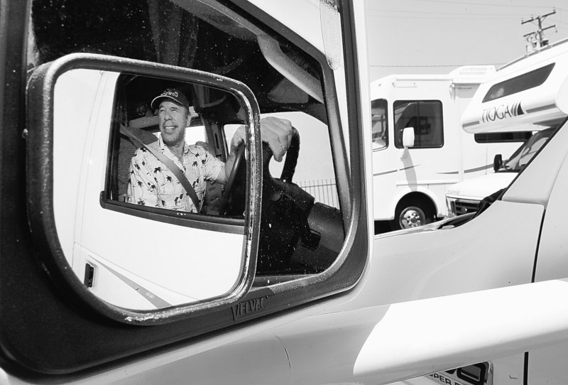 Sid Moreno, of Moorpark, Calif., drives away form a dealer's lot in a 29-foot motorhome as he heads out for the Memorial Day weekend.