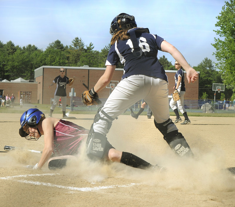Caroline Hamilton of Greely beats the tag by Yarmouth catcher Julie Dursema to score the Rangers' first run Friday at Yarmouth. Greely scored four times in the sixth inning to break open a close game and went on to an 8-1 victory.