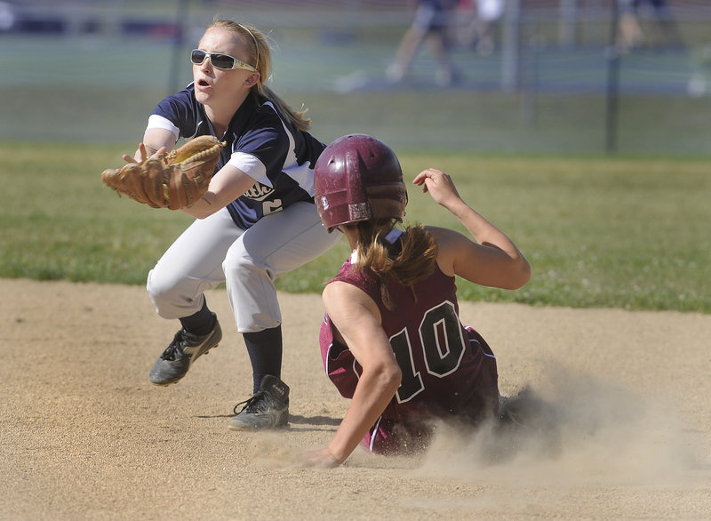 Yarmouth shortstop Rachel Mosher awaits the throw as Greely's Michelle Kahn slides safely into second base with a steal in the second inning.