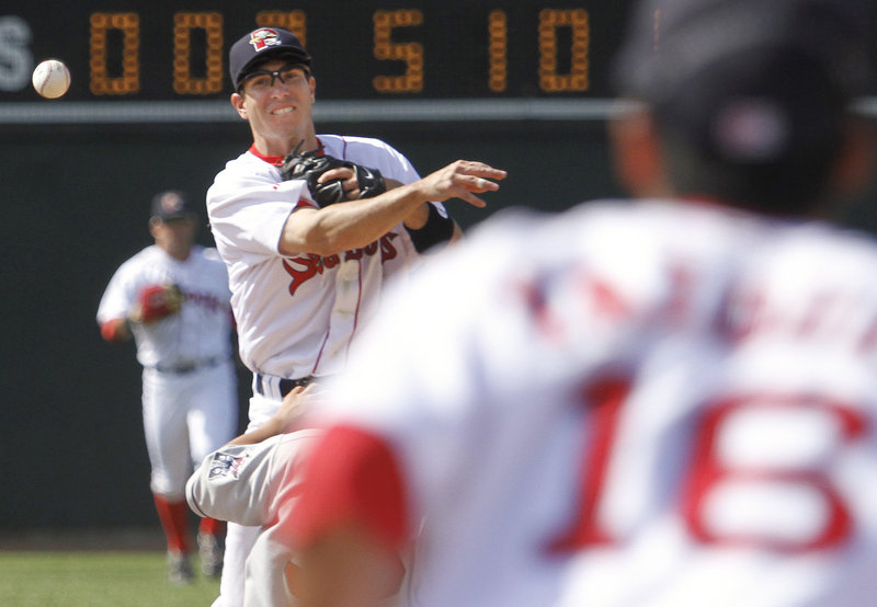 Nate Spears of the Portland Sea Dogs throws to first baseman Will Vasquez to complete a double play Sunday in the ninth inning of the 8-4 victory against the New Britain Rock Cats at Hadlock Field. The teams will meet again today in a game that will be televised by NESN.