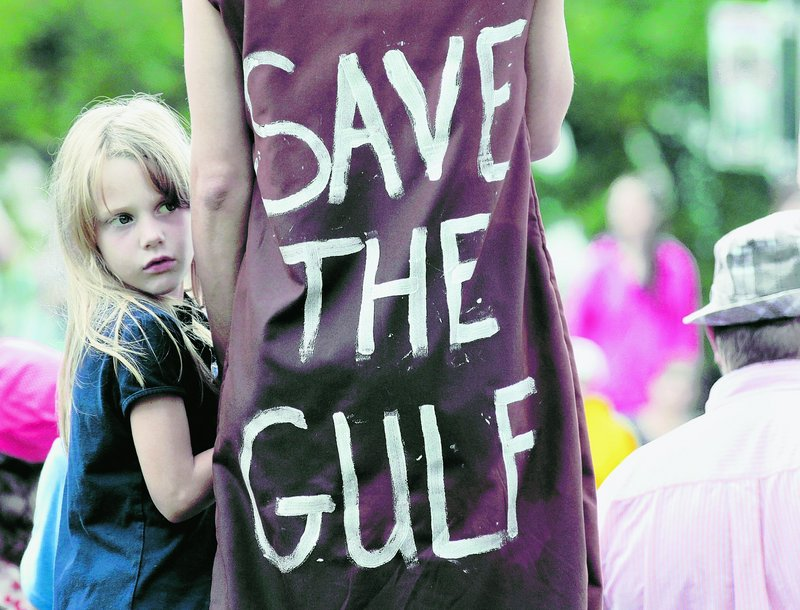 Jolie Van Gilder holds her mother's hand during a rally against the BP oil corporation and its role in the Gulf oil spill in New Orleans on Sunday.