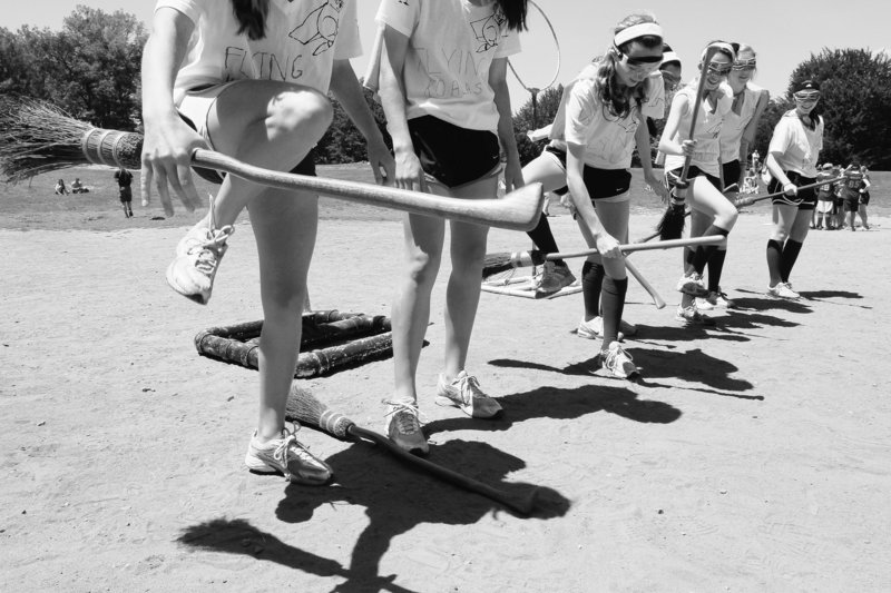 Members of the Flying Koalas, a Quidditch team from Westchester County, practice lifting their broomsticks with their feet as they wait to compete in a match in New York's Central Park Sunday. The event was hosted by the International Quidditch Association.