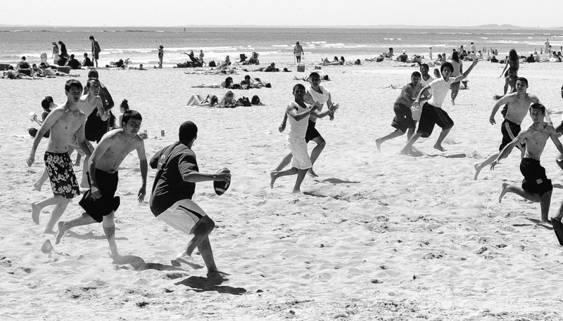 High school students on a field trip play football at Hampton Beach, N.H. For years the beach has drawn high school and college students, families and retired couples. The state has only 18 miles of seacoast but Hampton Beach is a jewel getting a $14.5 million facelift.