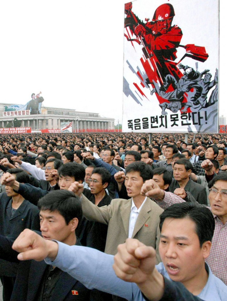 Thousands raise their fists Sunday in Pyongyang, North Korea, at a rally condemning South Korea and the U.S. over allegations that a North Korean torpedo struck and sank a South Korean warship.