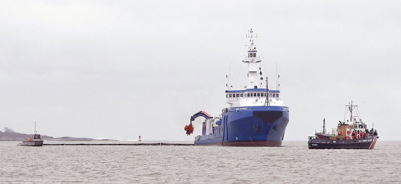 The Maine Responder (the large blue vessel) takes part in an oil spill cleanup drill in Portland Harbor.