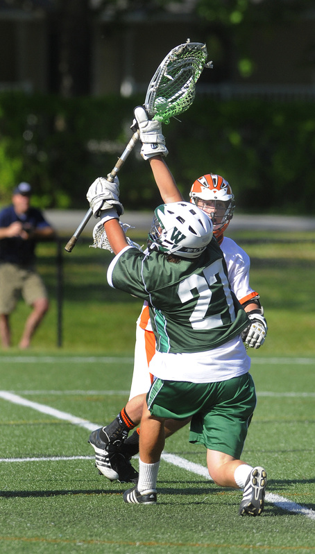 Will Hallett of Waynflete holds his ground Tuesday to make a save in front of Phil Champoux of North Yarmouth Academy. Waynflete earned a 15-8 victory at Yarmouth.