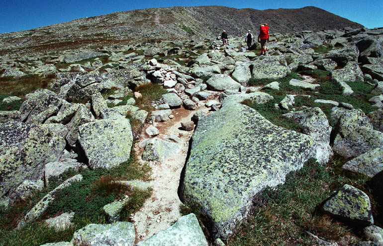 In this file photo, hikers make their way across Mount Katahdin's Tableland en route to the peak. Park rangers report that a foot or more of snow still covers the Tableland's treeless alpine tundra.