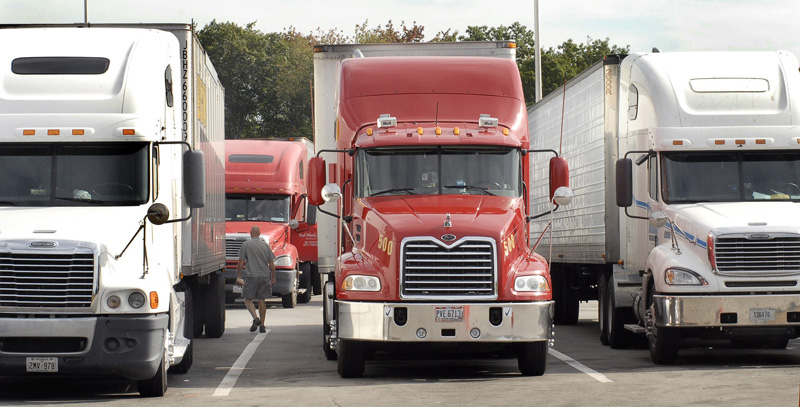 Trucks parked at the Kennebunk truck stop along the Maine Turnpike.