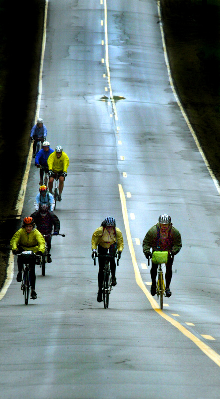 Cyclists cruise down a long hill during the 2005 Trek Across Maine.