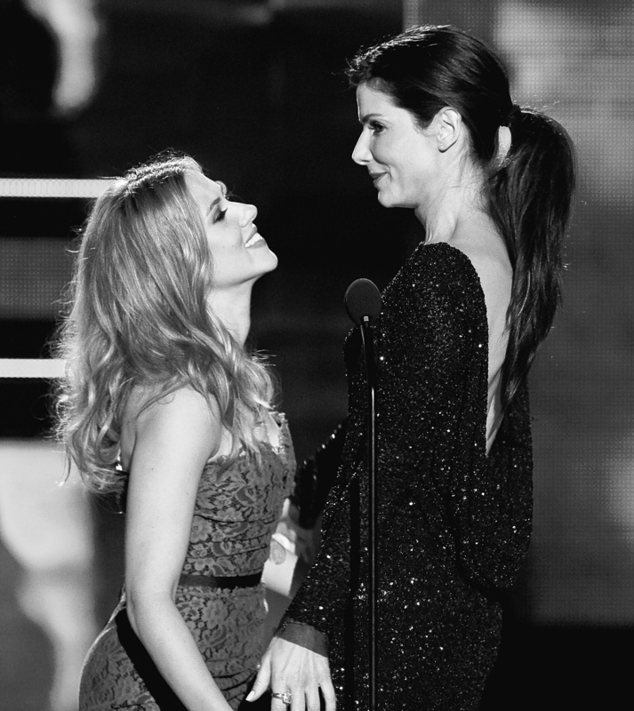 Scarlett Johansson, left, and Sandra Bullock appear onstage together Sunday at the 2010 MTV Movie Awards, where Bullock was honored with the MTV Generation Award.