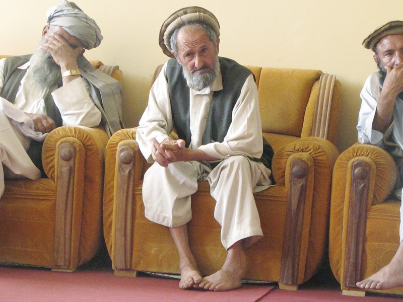 "A village elder listens to the discussion during the weekly ""shura,"" where leaders compare notes, talk about what's working and what isn't, and, most of all, complain."