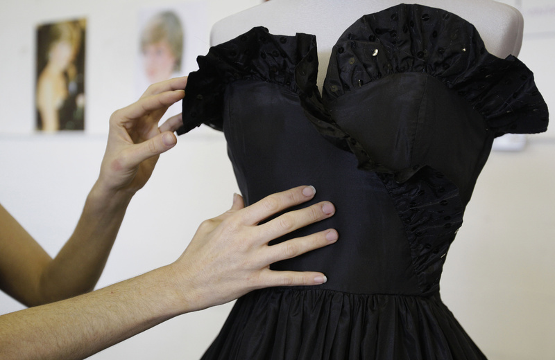 A black taffeta evening gown worn by Princess Diana is displayed, at an auction house in London. The dress is expected to fetch between $44,000 to $73,000.