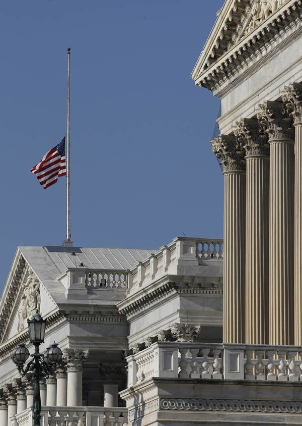 The flag over the U.S. Capitol flies at half staff in honor of the passing of Sen. Robert C. Byrd in Washington today.