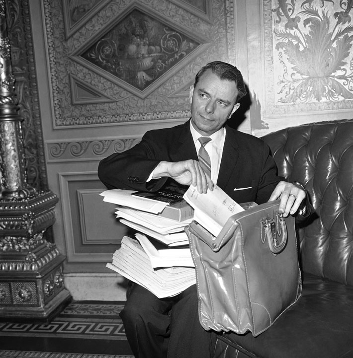 In this 1964 file photo, Sen. Robert C. Byrd repacks his briefcase after keeping the senate in a round-the-clock session with a more than 15-hour speech. The 46-year-old foe of the civil rights bill said he made his marathon speech in hope of defeating efforts to cut off debate on the bill. briefcase,democrat,politician,politics,senator