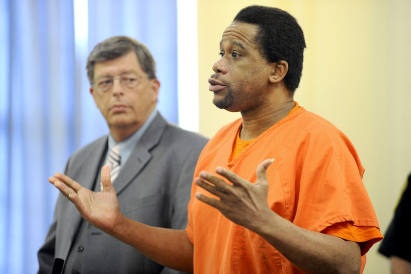 Rennie Cassimy, who pleaded guilty earlier this year to conspiracy for his role in the 2008 murder of Winston George in Old Orchard Beach, is seen here next to his attorney Cliff Strike as he speaks to York County Superior Court Justice G. Arthur Brennan.