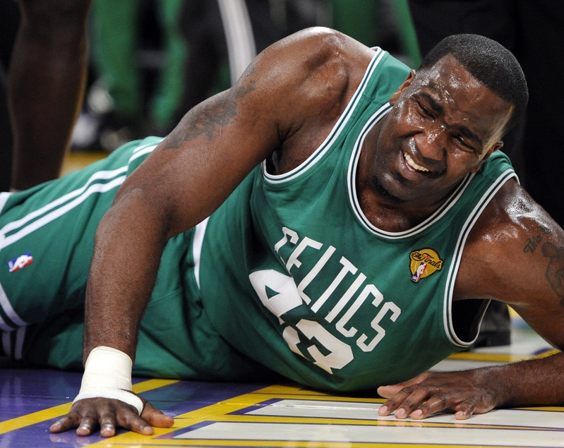 Boston center Kendrick Perkins goes down after suffering a knee sprain Tuesday in the first half of Game 6 of the NBA finals against the Lakers in Los Angeles. The Lakers beat the Celtics, 89-67, forcing a title-deciding Game 7 on Thursday in L.A.