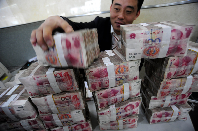 A clerk stacks yuan notes at a bank in China's Anhui province. The central bank has promised to allow more exchange-rate flexibility, a possible break from a policy in place since mid-2008, when China halted an earlier period of letting its currency appreciate against the dollar.