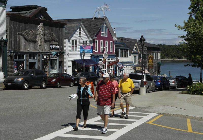 "Tourists stroll through Bar Harbor during a visit by the cruise ship Maasdam on June 4. ""The last two or three years, we've really spiked,"" said harbor master Charlie Phippen."