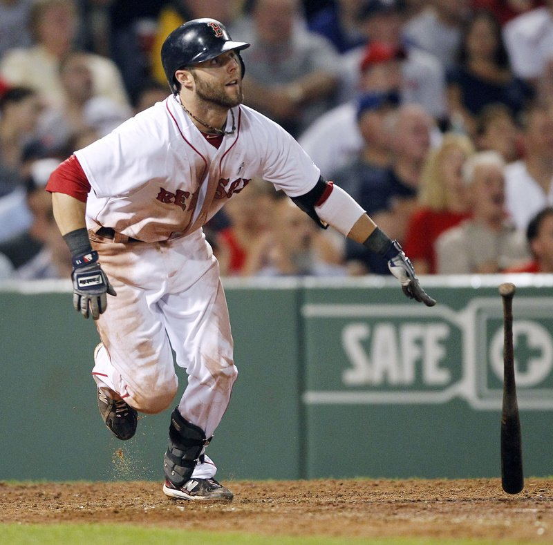 Boston's Dustin Pedroia watches his triple in the eighth inning in a game against the Dodgers Sunday in Boston. The Red Sox won 2-0.