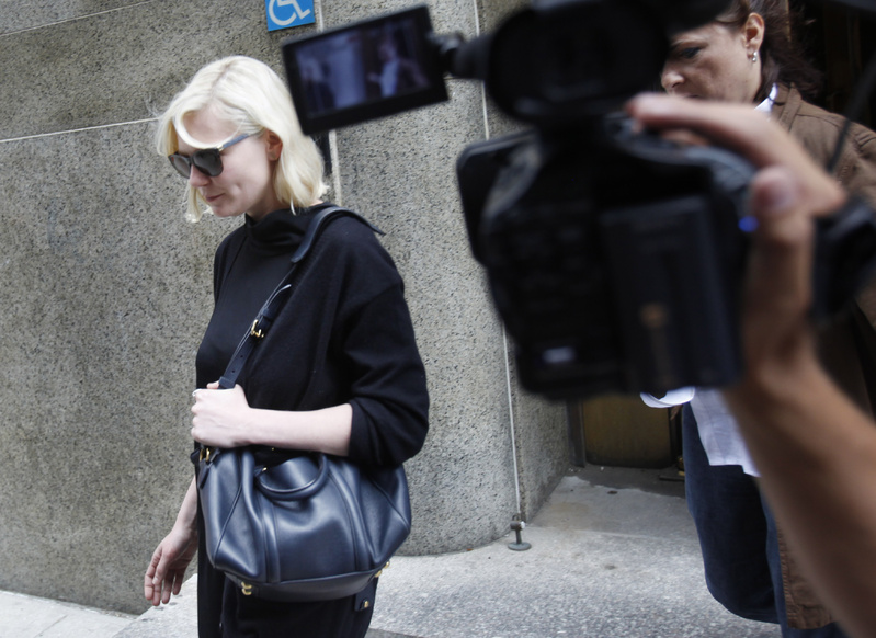 Actress Kirsten Dunst exits Manhattan criminal court in New York on Tuesday against a robber suspect.