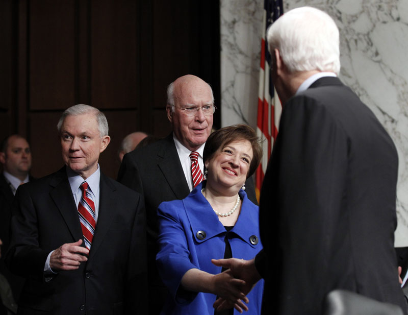 Supreme Court nominee Elena Kagan is escorted by the Senate Judiciary Committee's ranking Republican Sen. Jeff Sessions, R-Ala., left, and committee Chairman Sen. Patrick Leahy, D-Vt., second from left, as she arrives on Capitol Hill today for her confirmation hearings.