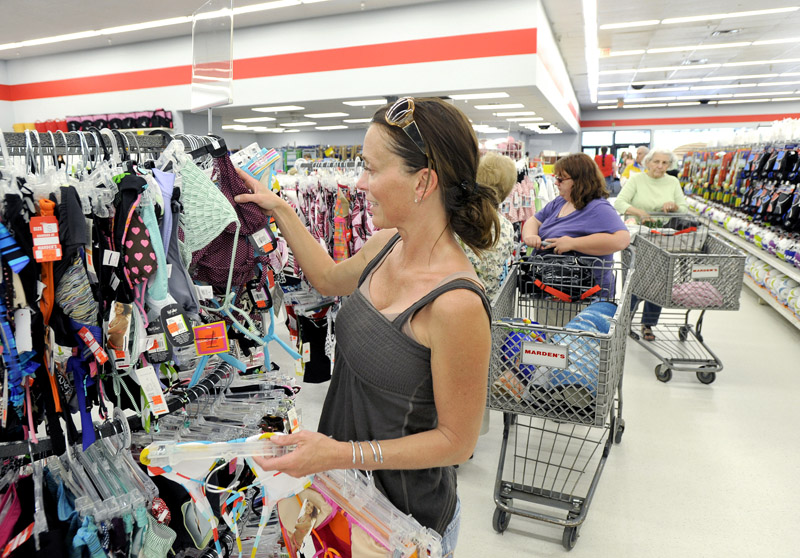 Shannan Burnell of Falmouth finds some geat prices in swimsuits as she buys several at Marden's today in Scarborough.