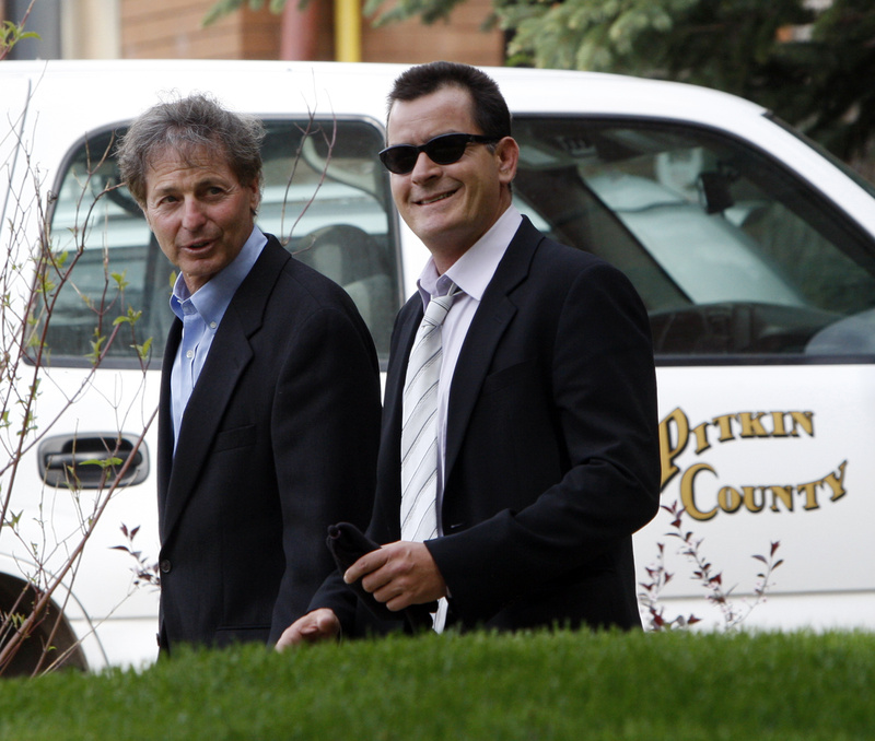 Charlie Sheen leaves the Pitkin County Courthouse with his attorney Richard Cummins in Aspen, Colo., on Monday. Sheen's hearing was continued until July 12.