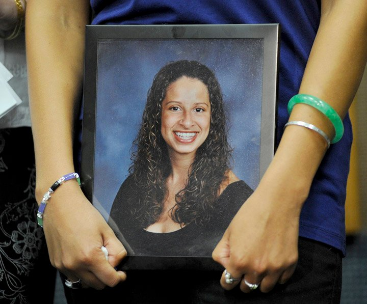 In this file photo, Sarena Richardson holds a picture of her sister Darien during a press conference at the Portland Police Department on May 13 2014. Darien Richardson suffered a gunshot wound during a home invasion and died two months later of a blood clot.