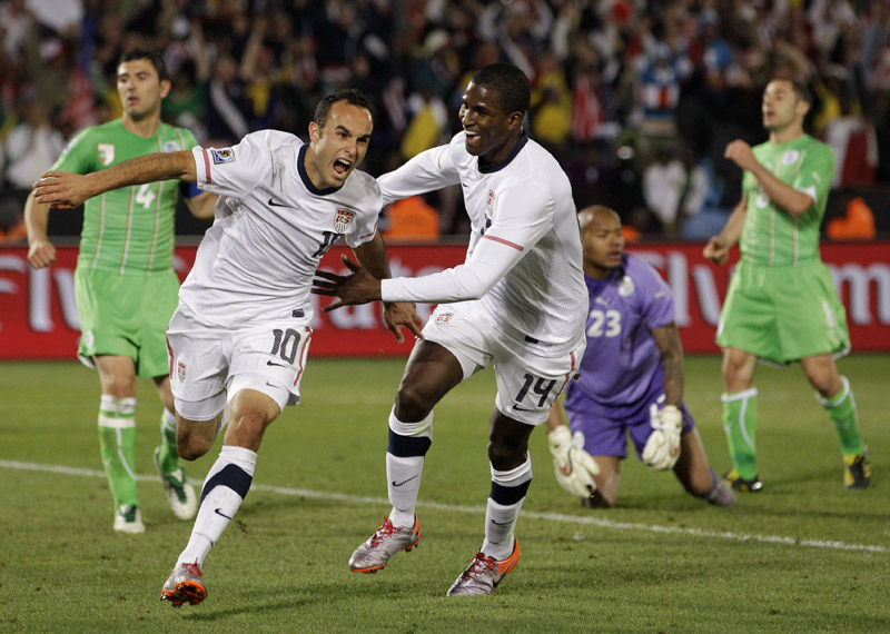 United States' Landon Donovan, foreground left, celebrates after scoring a goal with fellow team member Edson Buddle as Algeria goalkeeper Rais M'Bolhi, second from left in background, reacts during the World Cup group C soccer match in Pretoria, South Africa today.