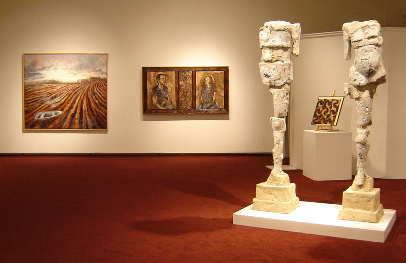 "Installation view including ""Upright Figures"" by Donna Caron, 2008, concrete and various media, 71 inches high; Deborah Randall's ""Dry Land"" (far left), 2008, oil on canvas, 64 by 72 inches (courtesy Elizabeth Moss Galleries); and Kelly Sue Rioux's ""Until I Am Bones (Adam and Eve),"" 2009, mixed media, 32 by 60 inches (courtesy Susan Maasch Fine Art)."