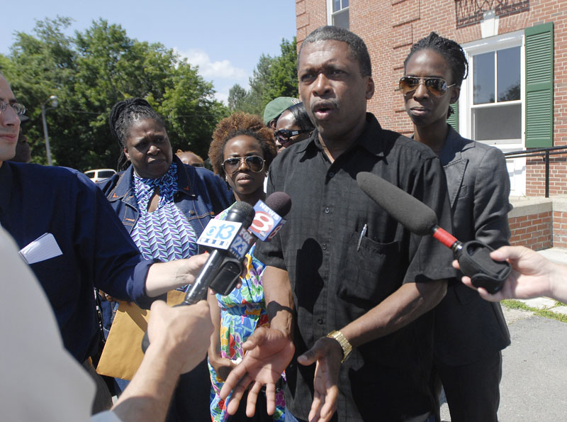 Whitfield George, brother of murder victim Winston George, and several family members gather outside the courthouse to talk with the media following the guilty verdict against Darlene George and Jeffrey Williams.