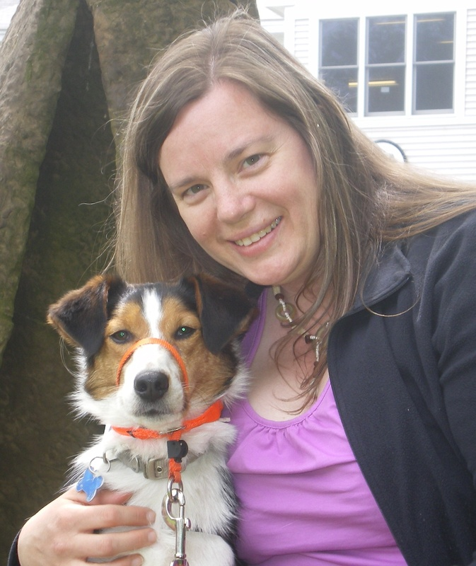 Deborah Baker, a recent graduate of NEADS, poses with her hearing dog, Rusty, who has provided her with a new found sense of freedom.
