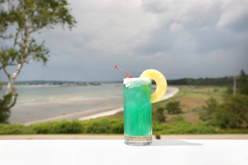 Even if you can't spring for a Fourth of July weekend at the Black Point Inn in Scarborough with its spectacular ocean views, you can enjoy a celebratory sip with bartender Eric Dore's Prouts Neck Cocktail.