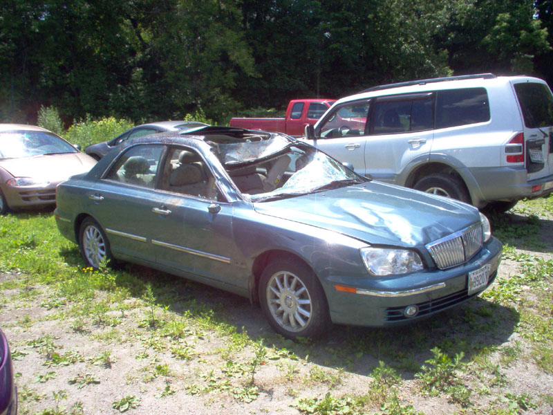 CRUSHED COVERING: The roof of Cathy Shepherd's 2004 Hyundai XG350 was flattened Sunday night when her car slammed into a moose on Interstate 95 in Waterville.