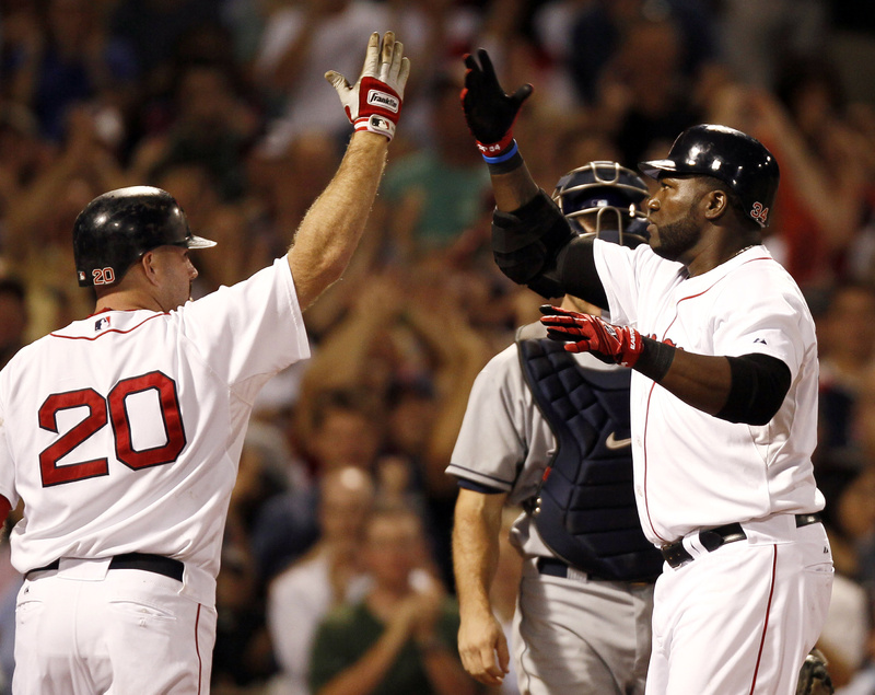 David Ortiz, right, is welcomed by Kevin Youkilis after hitting a three-run homer in the fifth inning Tuesday night, snapping a scoreless tie and starting the Boston Red Sox to an 8-5 victory against the Tampa Bay Rays at Fenway.