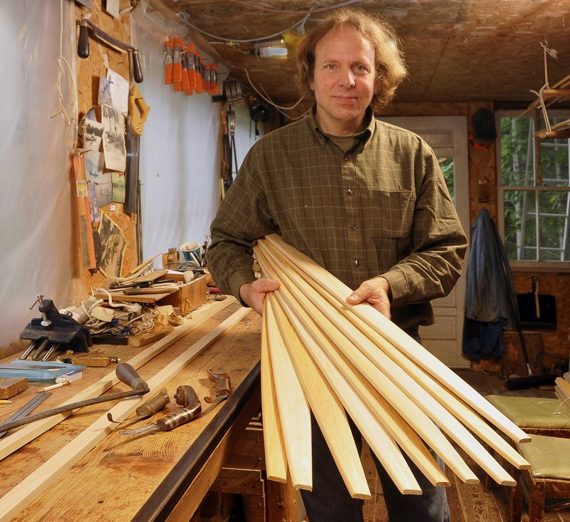 Steve Cayard in his workshop in Wellington with cedar ribs that will be soaked and bent for the framework of a birch canoe he is building in the traditional American Indian fashion.