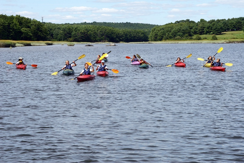 Young kayakers take part in a program last August at Chewonki in Wicasset. New adventures are planned for this summer.