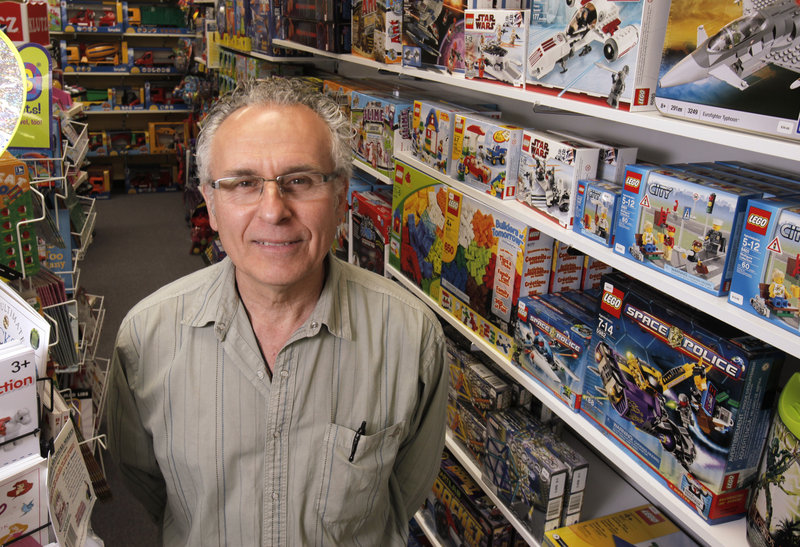 "Jim Demetropoulos co-owns Island Treasure Toys in Yarmouth with his wife, Anita. They started selling wooden and natural toys and expanded to offer ""carefully planned purchases of all toys."""