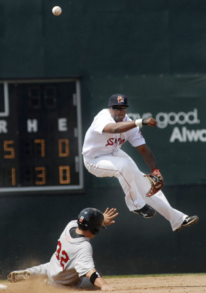 Eric Lis of the New Britain Rock Cats can't break up a double play turned by Sea Dogs shortstop Yamaico Navarro.