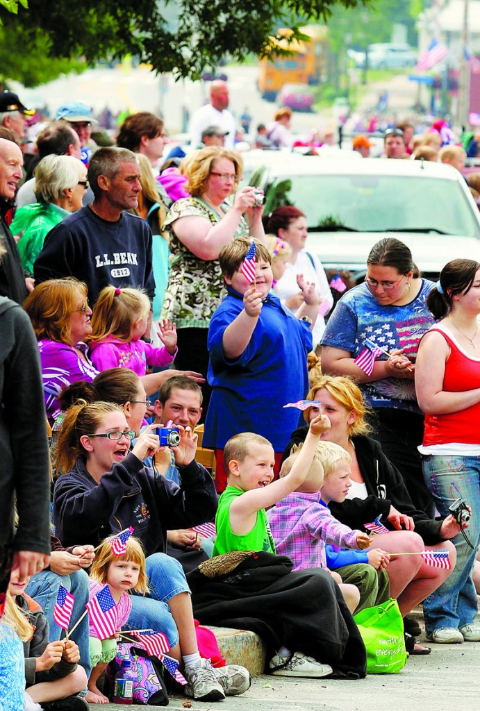 A crowd watches the parade Monday in Brunswick. As the Brunswick Naval Air Station approaches its closure, only a couple hundred military personnel remain based there.