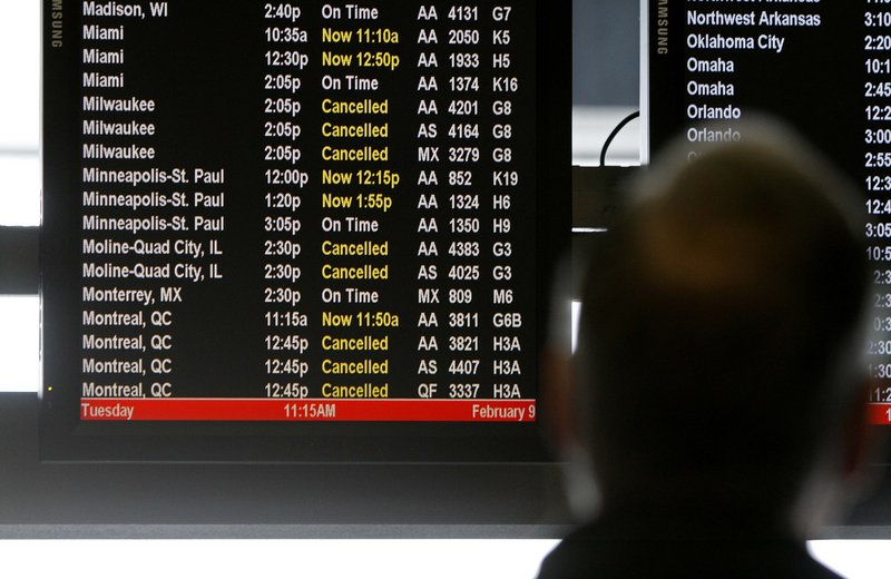 An American Airlines passenger checks the departure board at Chicago's O'Hare Airport. In the first three months of 2010, American Eagle, American Airlines' regional affiliate, was the most likely to bump passengers; JetBlue has been the least likely.